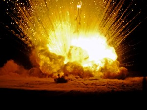 A large explosion of confiscated mortar rounds, grenades, guns and other explosive devices set up by Army explosive ordnance disposal technicians on Contingency Operating Base Q-West, Iraq, Dec. 31. The controlled blast, which contained more than 1,500 pounds of explosives, was set off at midnight as a way to ring in the New Year from Iraq.